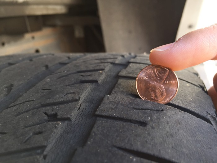 Balding tires. Very worn tires that have little to no tread